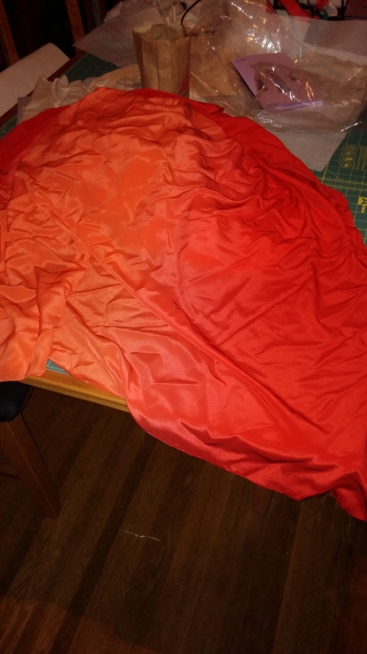 THAT SILK CREPE, THO. Red to coral to orange and back again, starring Bilbo Baggins...