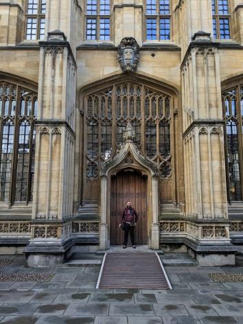 Tom in front of the door